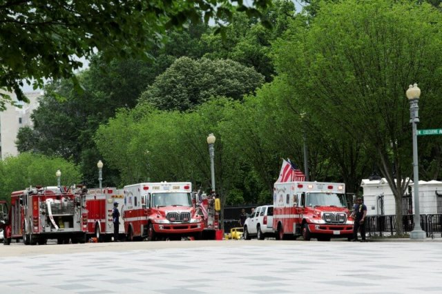 Firetrucks and ambulances are seen on Pennsylvania Avenue in front of the White House in Washington during a security lock down, U.S., May 30, 2016. REUTERS/Yuri Gripas