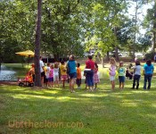 Children waiting in line for a balloon at Arts in Wayne park, during Sunday in the Garden.
