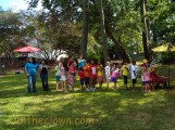 Children and parents waiting for a balloon animal at Sunday in the Garden, sponsored by the Arts Council of Wayne County.