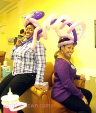 Event organizers showing off their new hats.