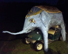 That's a golf cart dressed up to resemble an elephant. It could squirt water.