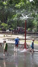 The Goldsboro fire department opened a hydrant and set up a power sprinkler so children could play in the water.