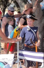 Pirate boy meets pirate parrot (macaw).