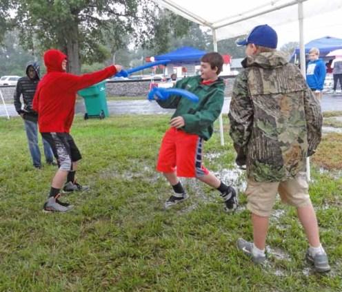 Swordfighting in the tent.