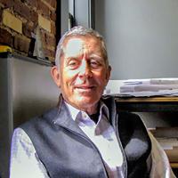 Portrait of UC-B Owner, John Hoffman: caucasian man in an office.
