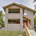 Renovated two story duplex with covered porch / balcony on each level
