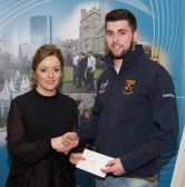 rragh Meaney receiving his prize from Linda Ryan, Bank of Ireland