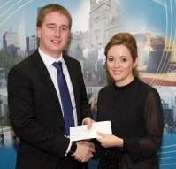 Ciaran Williams receiving his award from Linda Ryan, Bank of Ireland