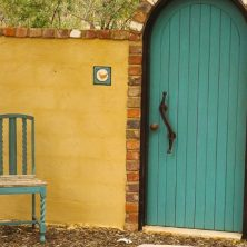 The door with the chair to rest before entering the Secret Garden - in Autumn