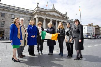 19/4/16 ***NO REPRO FEE*** Funding of €144,000 Announced by Irish Research Council for 1916-Themed Projects Pictured today (19.04.16) at the announcement by the Irish Research Council of €144,000 in funding for 1916-themed research projects were Researchers who received funding Niamh Moore- Cherry, John Howard and Amber Cushing from UCD, Lisa Godson from NCAD with Professor Jane Ohlmeyer, Chair of the Irish Research Council (centre) Ciara Breathnach from Maynooth college, Armida de la Garza from UCC and Dr. Eucharia Meehan, Director of the Irish Research Council (far Right) holding a period flag outside the GPO on Dublin's O'Connell Street Pic: Marc O'Sullivan