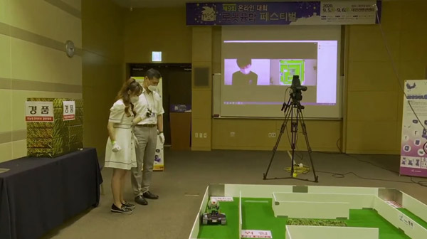 Participant controlling robot car in M-TECH Creative and Intelligent Robot Competition