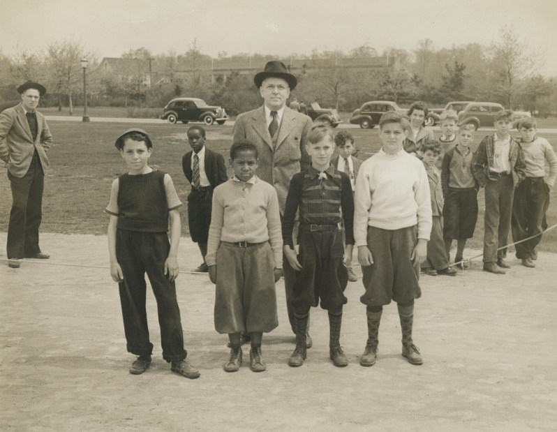 Winners of the Tenth Annual Marble Tournament, posing foe a photograph. W.R. Tracey, Engineer and Secretary of the Park Commission standing in the background. May 1940