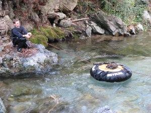 A researcher installs an instrument buoy at Landels-Hill Big Creek Reserve. Image courtesy Gage Dayton