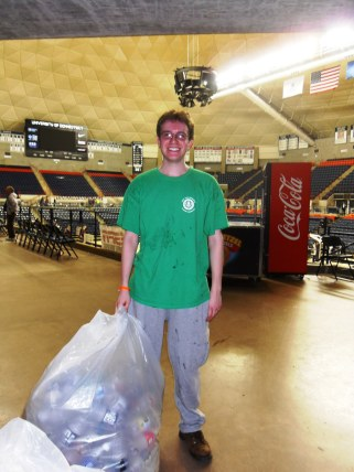EcoHouse volunteer collecting leftover recyclables after the game.