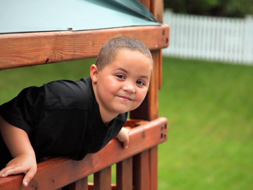 Smiling latino teen boy portrait outdoors