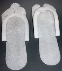 Single-use flip-flips, maker unknown, early 1990s. Unidentified plastic foam sheeting. Collection, Katherine C. Grier.