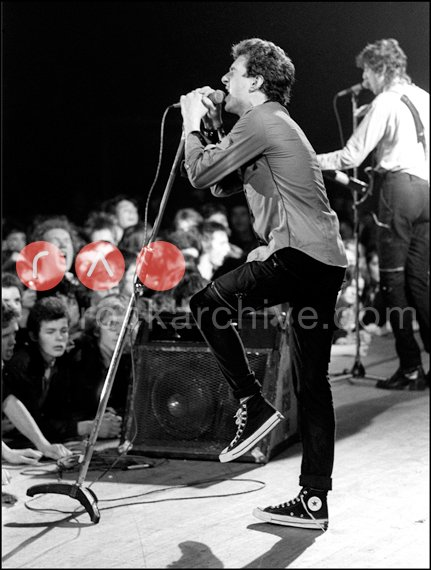 Joe Strummer of The Clash performing with Chuck Taylors
