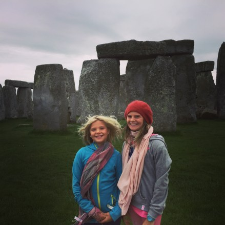 Summer at Stonehenge, complete with scarves & beanies