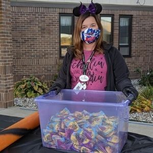 Staff member prepares to hand out candy