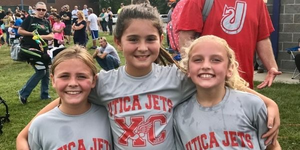 Cross-country runners pose following meet