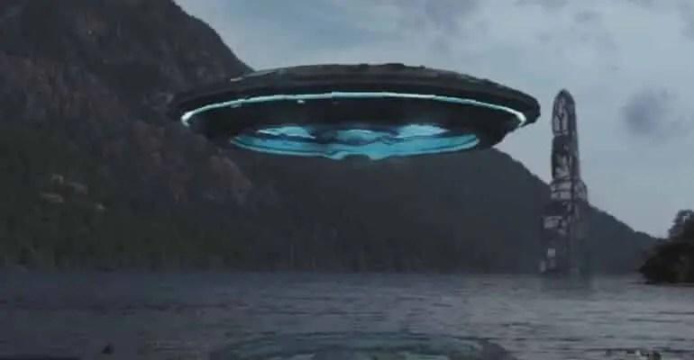 ufo over lake near mountain