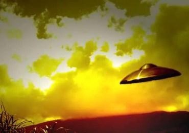 ufo flying near clouds