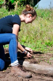 Not afraid to get her jeans muddy, River Wittke plucks every last weed from the bed.