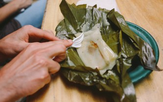 Resident naturalist Mason Strawser samples the tamales for sale at el Día de San Luis on Sunday, June 19, 2016. (Photo/Rachel E. Eubanks, www.rachel-eubanks.com)