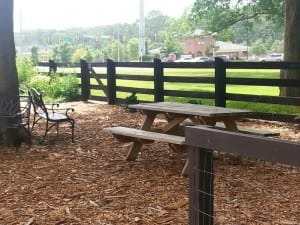 A shaded seating area at Green Meadows Community Garden in Cobb County.