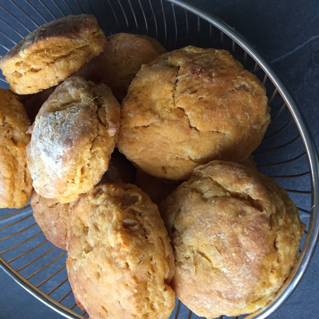a basket full of sweet potato biscuits
