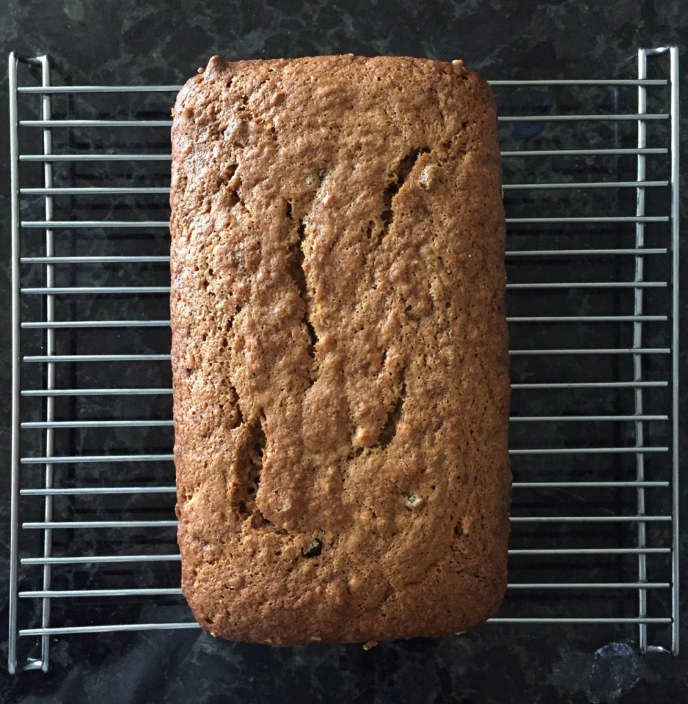 a loaf of one bowl chocolate chip banana bread on a cooling rack