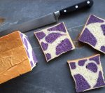 the final attempt at the purple cow milk bread, with three slices cut from the loaf