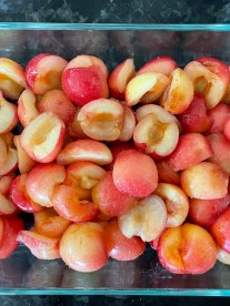 A shallow baking dish filled with the Rainier cherry mixture