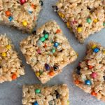 a picture of cut peanut butter rice krispie treats with colorful rainbow chips
