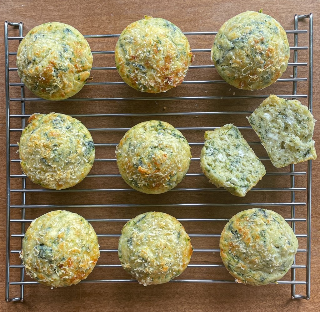 spinach and feta muffins on a cooling rack