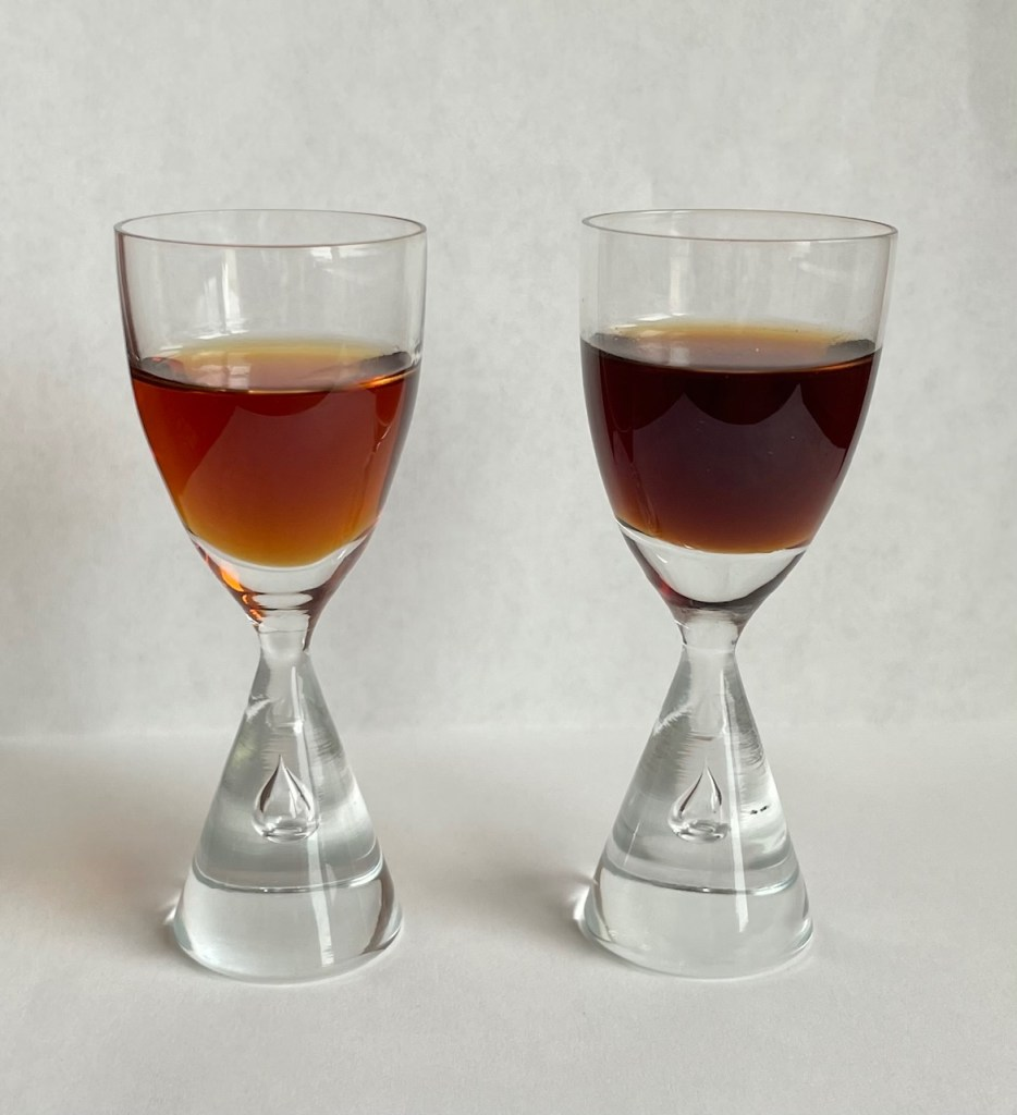 a sipping glass filled with Tia Maria on the left and Kahlua on the right