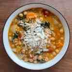 a bowl of garbanzo bean soup topped wtih Parmesan