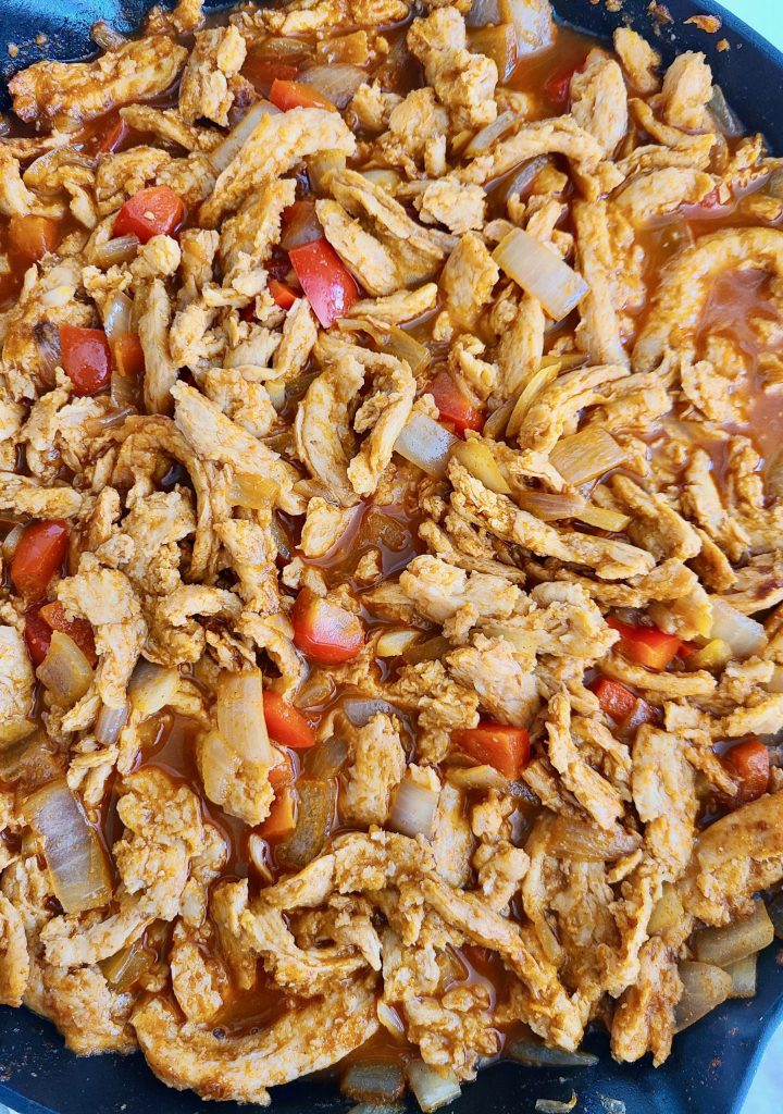 soy curls, bouillon, water, red peppers, onions, and garlic in a skillet