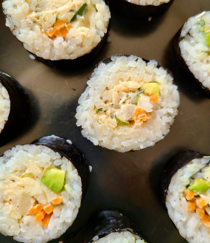 Vegan crab salad in homemade sushi rolls