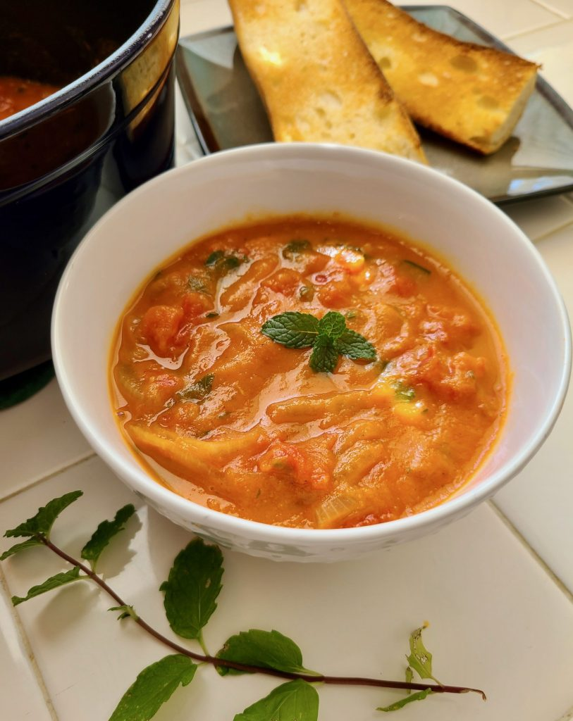 Vegan Roasted Garlic Tomato Soup topped with mint
