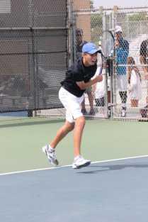 Patrick Kozlowski (Fr.) serves in a match against Marina High School. (Diana Zhang)