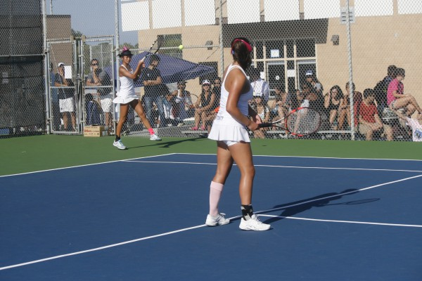Ashlyn Wang (Jr.) returns a hit as her partner, Michelle Maddox (Sr.), and the Game of Week spectators watch. (Danya Clein)