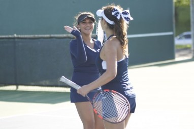 First-time partners Michelle Maddox (Sr.) and Reeyah Chopra (Sr.) high-five after a point. (Alex Novakovic)