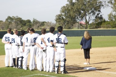 The Trojans stand for the Star Spangled Banner before the first pitch against SJHHS. (A. Novakovic)