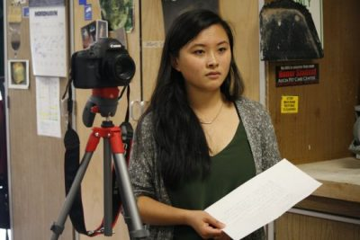 """Bethany Huang (Sr.) conducting an interview for her Video Production Project """"A Portrait of the Arts: Ceramics"""" last year (Vicki Li)."""