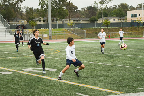Lee McElligot (So.) steps forward to trap a bouncing ball in CdM game. (C.Chen)