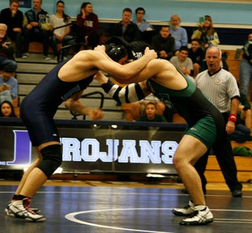 Wrestling loses to Irvine in third home game