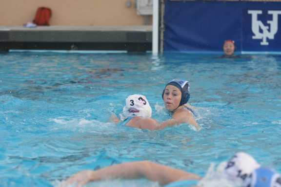 Alison Huxman (Jr.) presses on the opposition during a defensive play (Jr.)