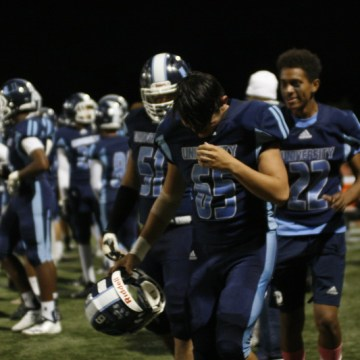 Football falls to Woodbridge in rivalry game