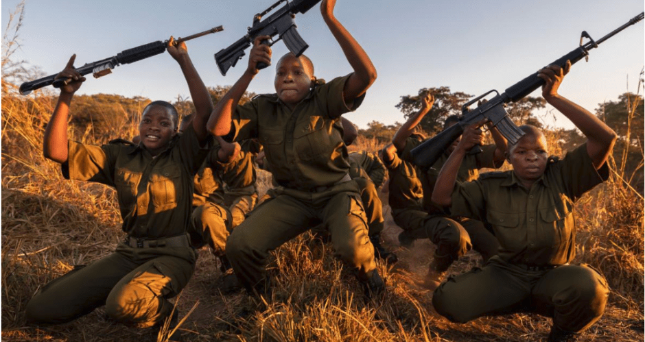 """The rangers train with rifles, though some conservationists argue that arming the women increases the threat of violence. Akashinga founder Damien Mander disagrees. """"With the women, [the rifle] is more of a tool. With the men, it's more of a toy,"""" he says. PHOTOGRAPH BY BRENT STIRTON"""